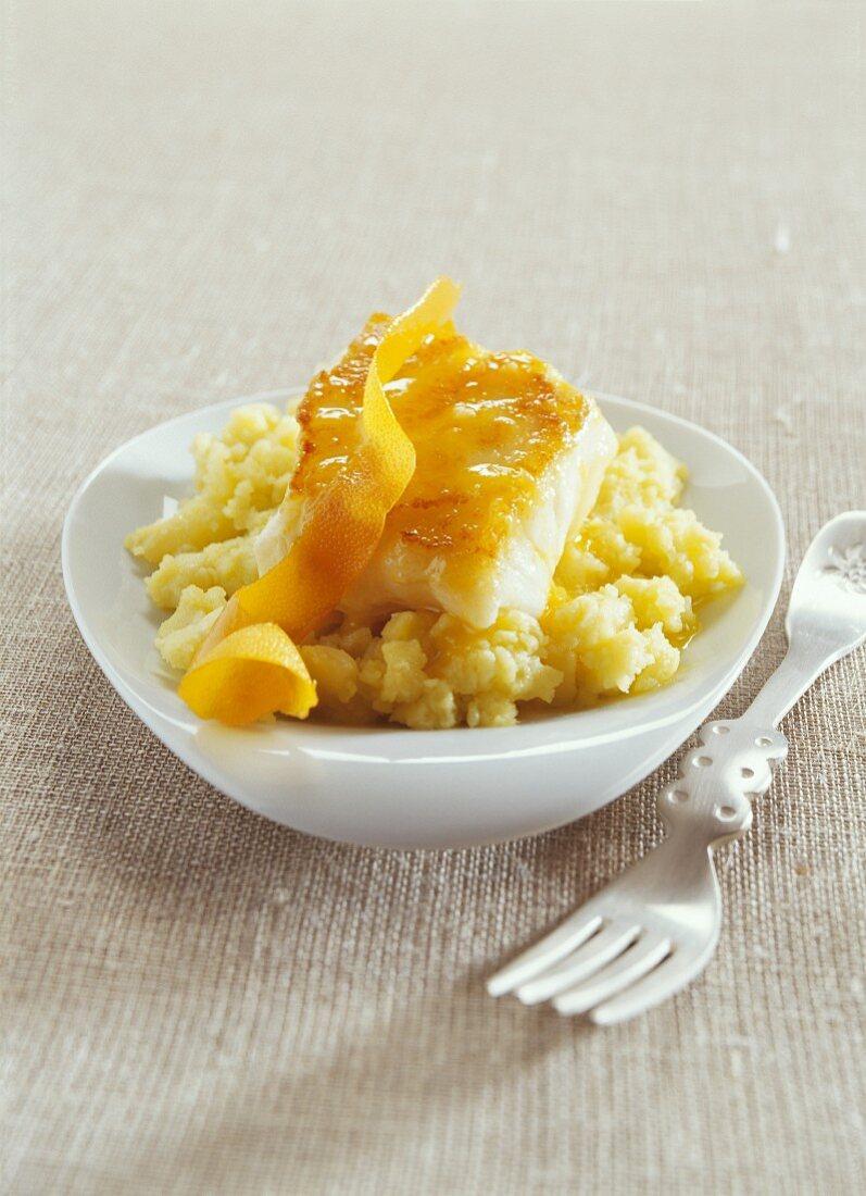 Cod steak on mashed potatoes with orange olive oil