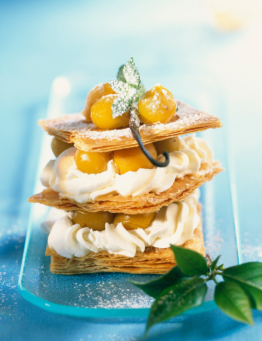 Flaky pastry,mirabelle plum and whipped cream dessert