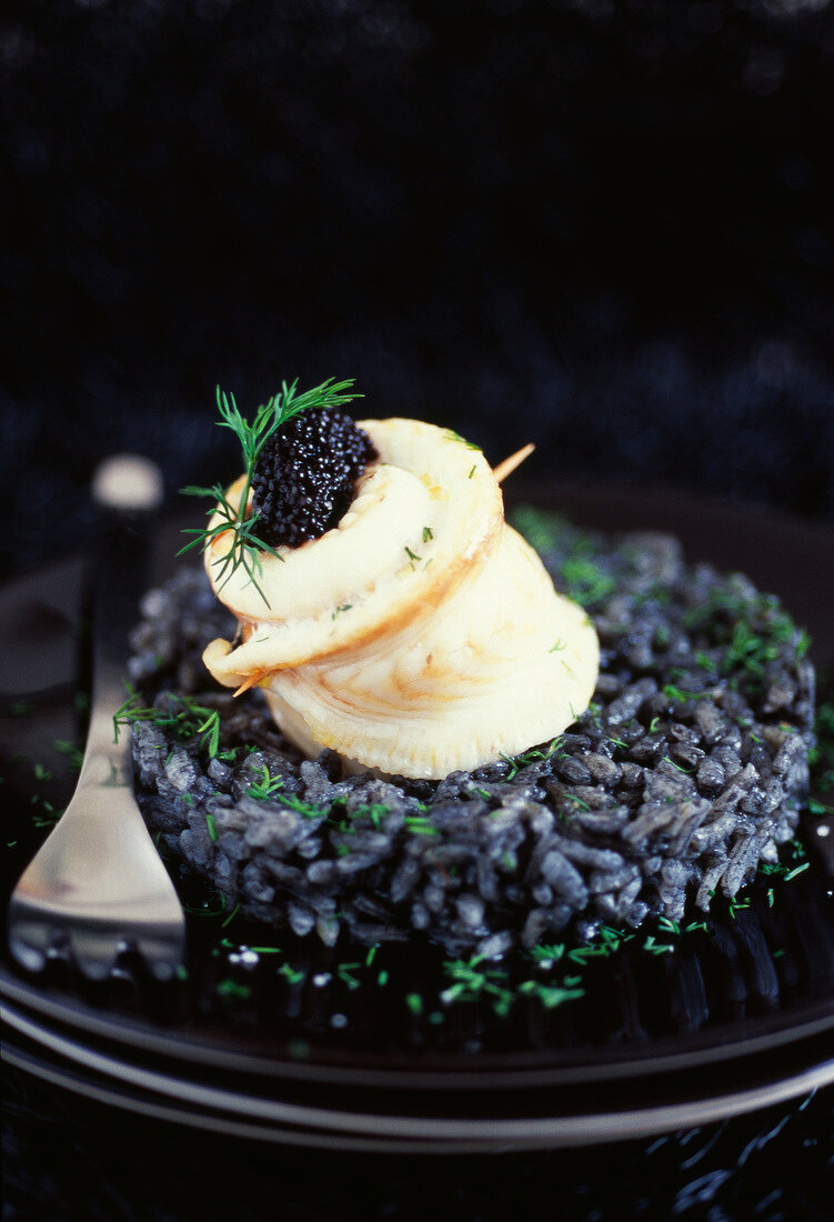 Sole fillet with Sevruga caviar and squid ink risotto