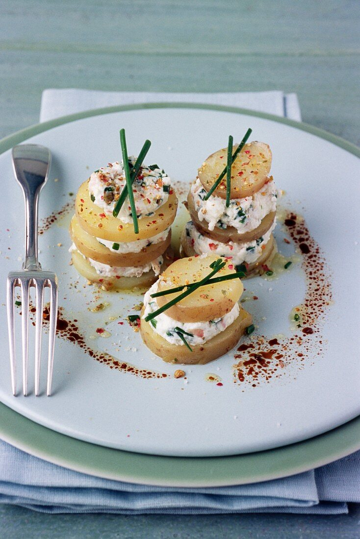 Small Ratte potato, goat's cheese and herb Mille-feuille
