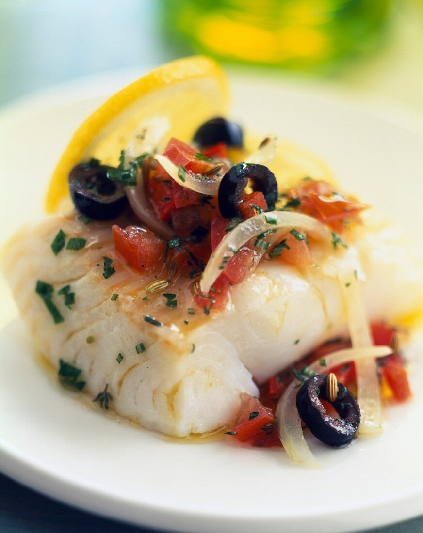Alaska cod with tomatoes and olive