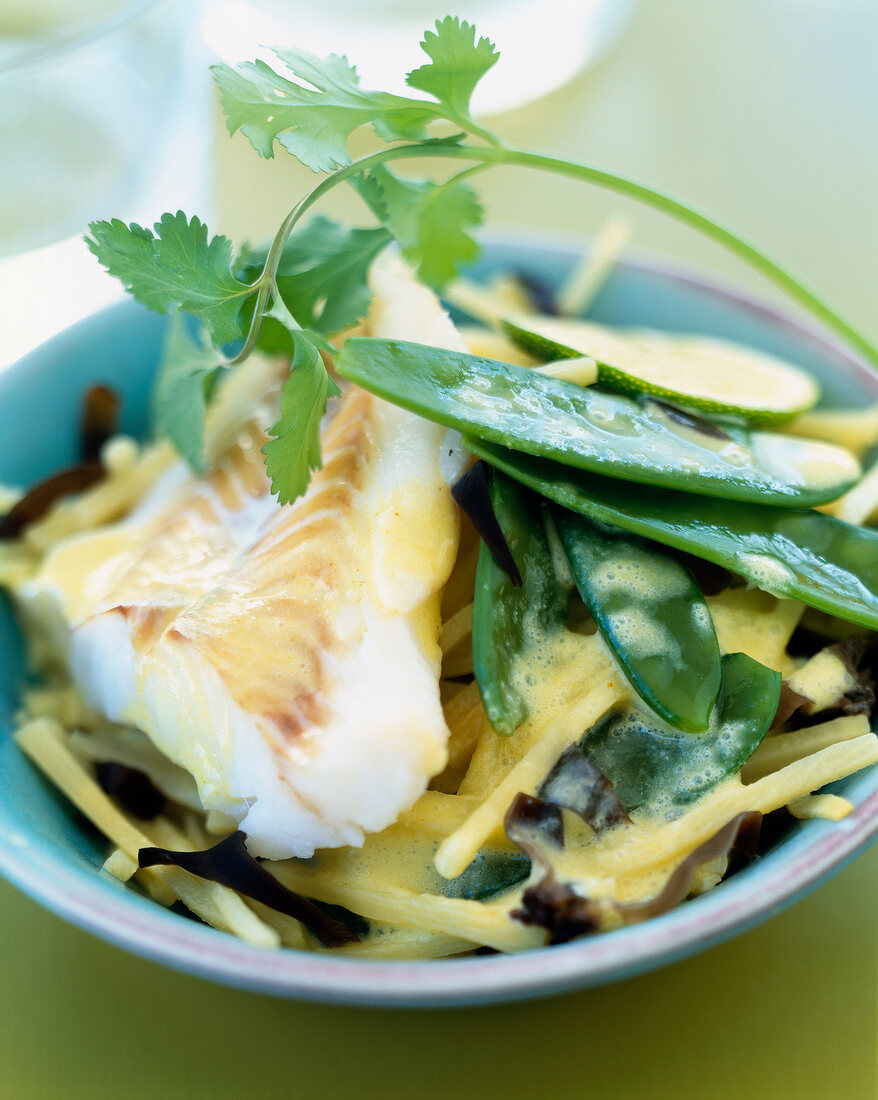 Alaska cod with lemon and coconut milk sauce