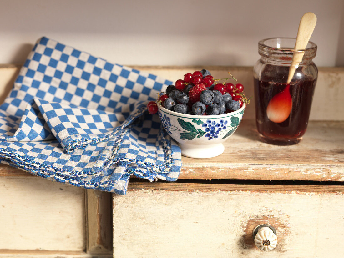 Bowl of summer fruit and summer fruit jelly