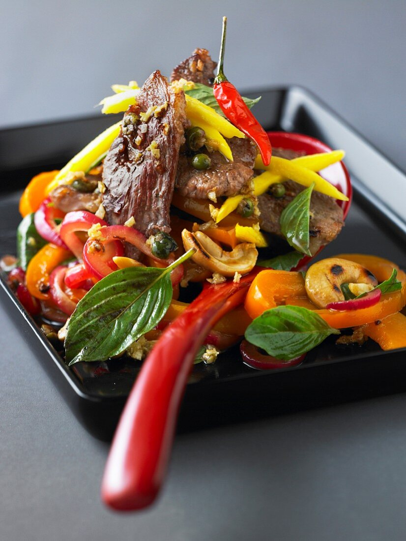 Sauteed duck with green pepper, mango and cashews