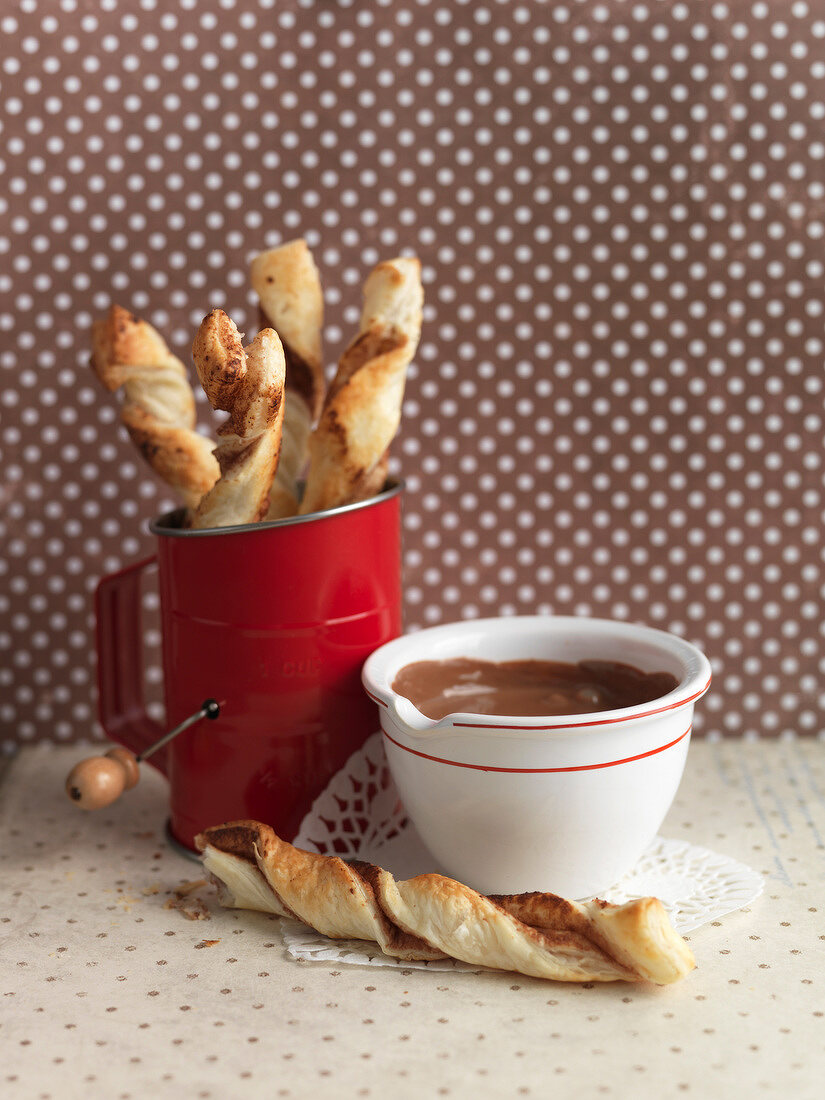 Flaky pastry twists and chocolate cream