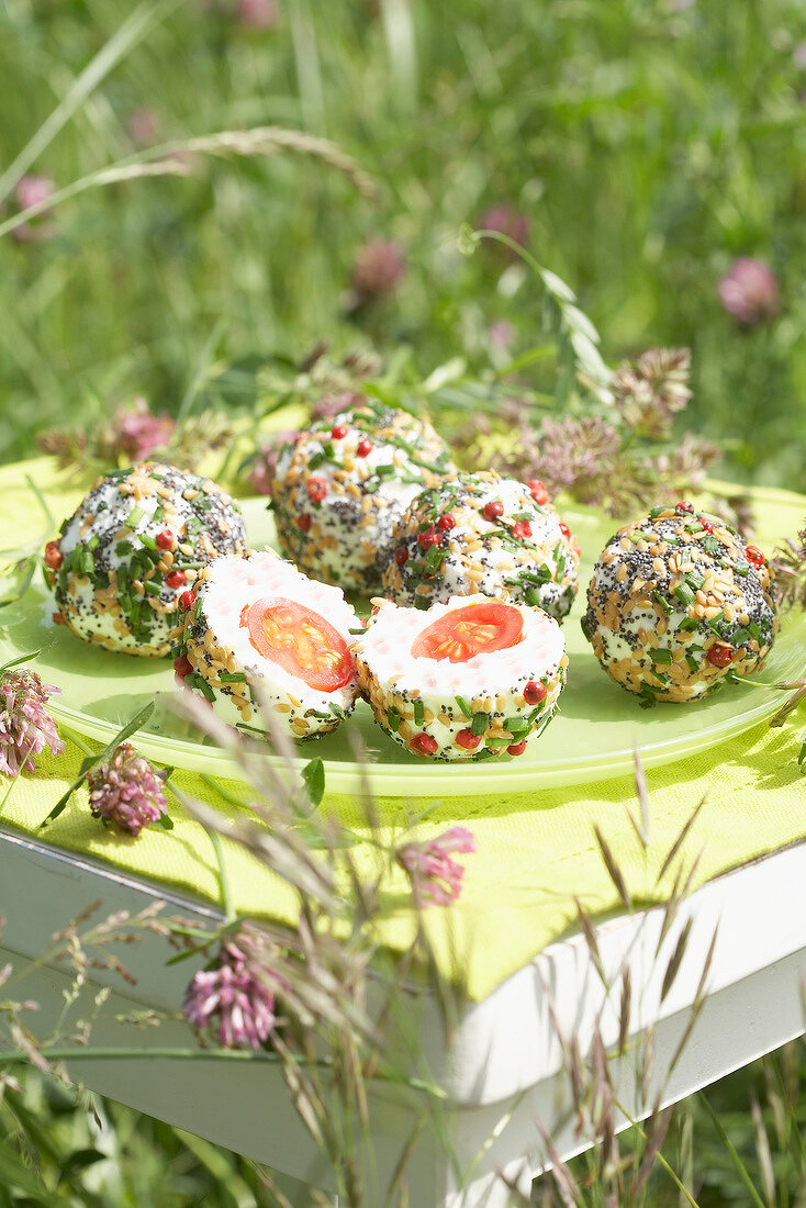 Cherry tomato and goat's cheese balls coated with poppyseeds,pine nuts and pink peppercorns