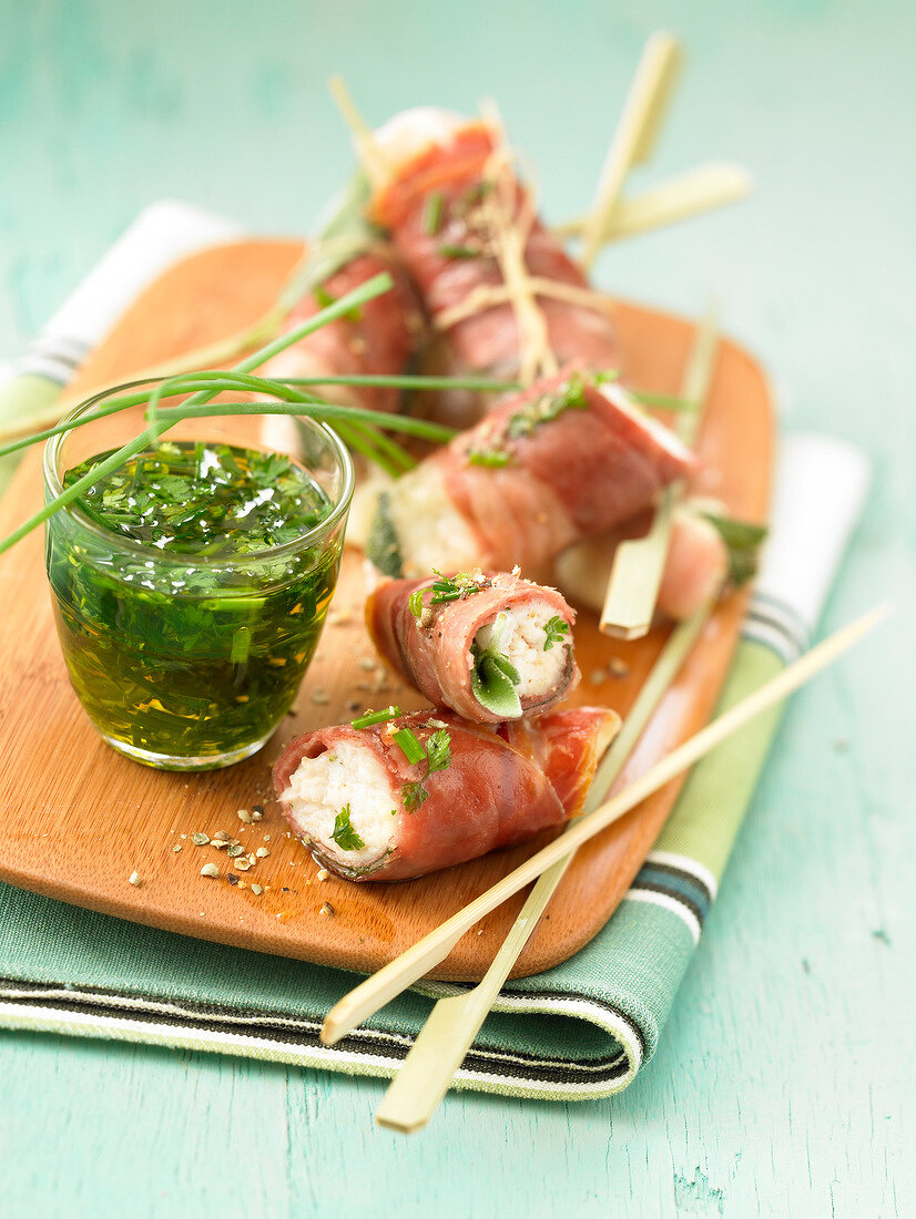 Raw ham and cream cheese rolls with herb sauce