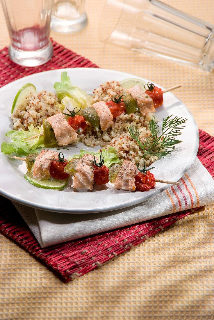Three-colored salmon brochettes with quinoa