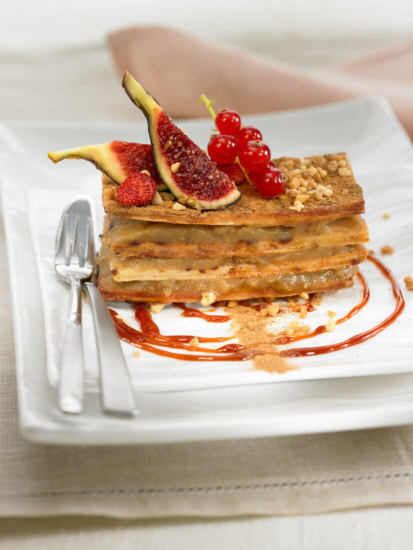 Stewed apple and flaky pastry layered dessert