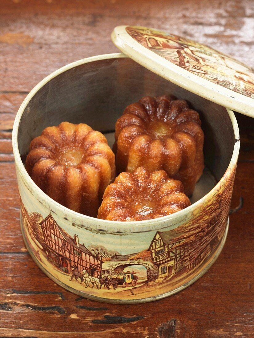 Cannelés in a tin box