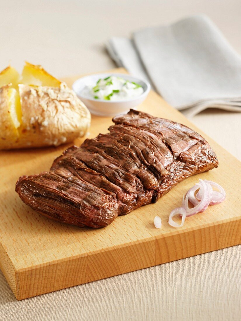 Grilled sirloin steak with a baked potato