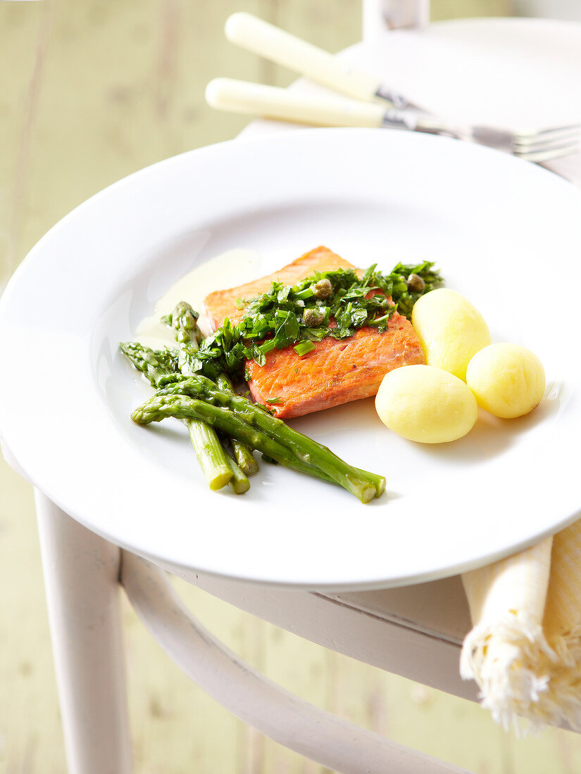 Salmon steak with green asparagus,herbs and steam-cooked potatoes