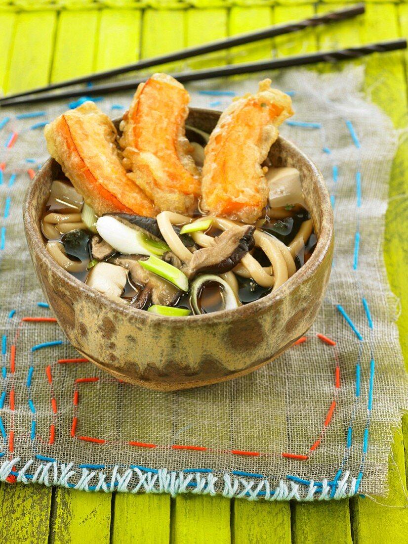 Udon pasta, shitake, tofu, and seaweed broth with Kabocha tempuras