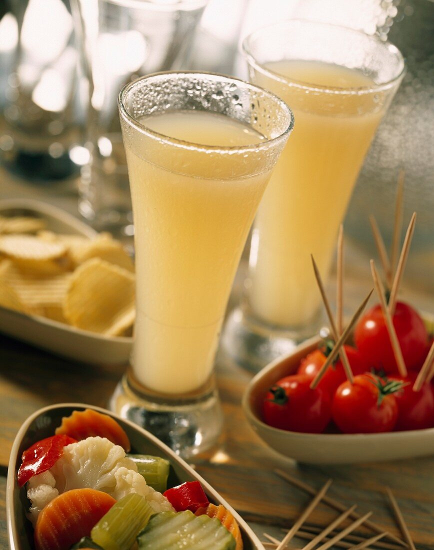 Glasses of Pastis with appetizers