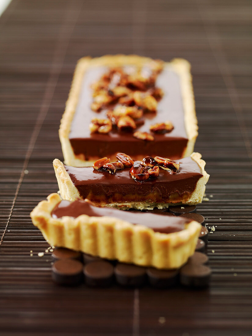 Cookie dough chocolate tart topped with caramelized peanuts