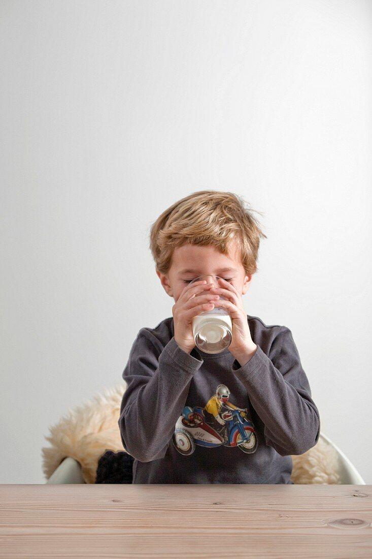 Boy drinking a glass of milk