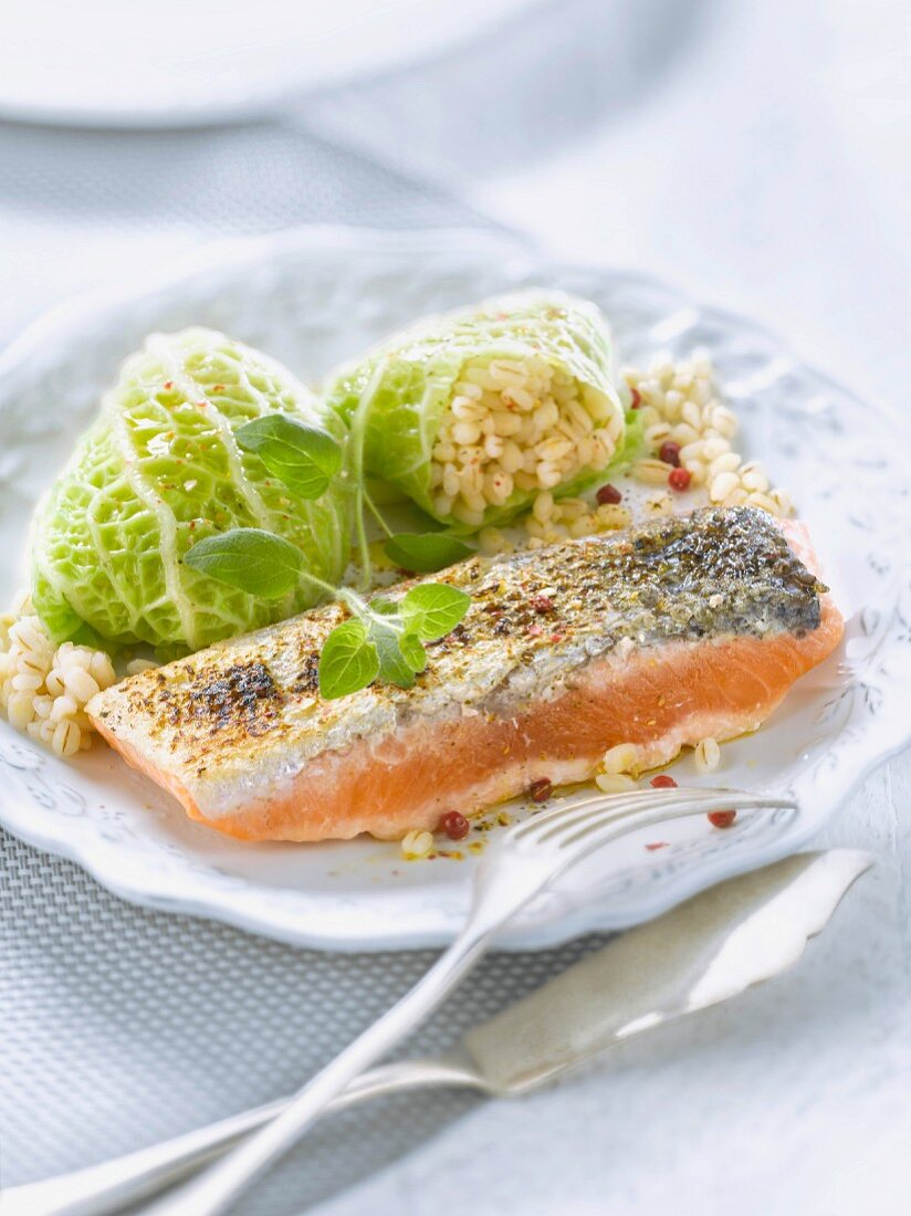 Thick piece of salmon and cabbage stuffed with barley
