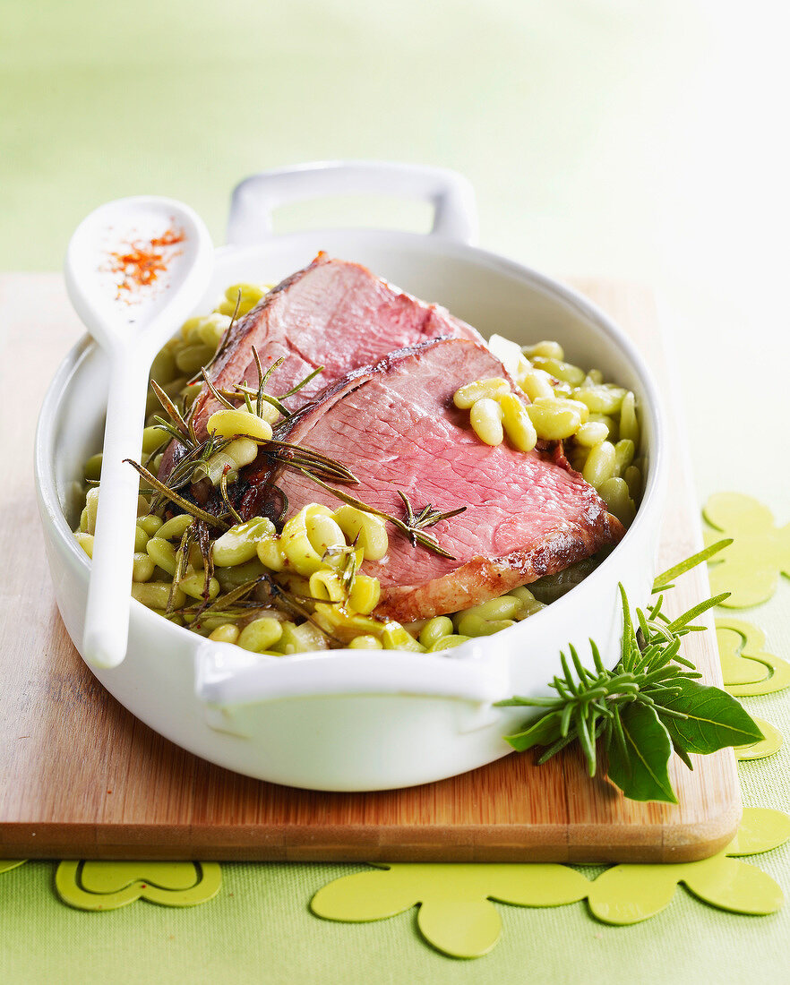 Leg of lamb with rosemary and flageolet beans