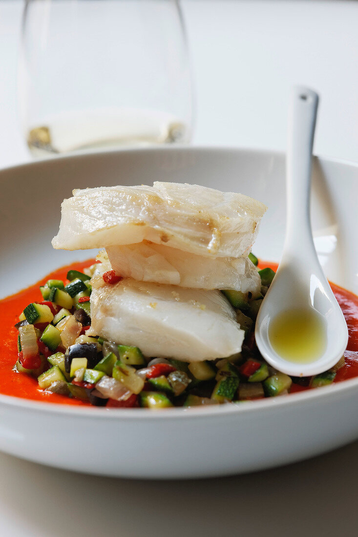 Piece of cod on a bed of diced southern vegetables