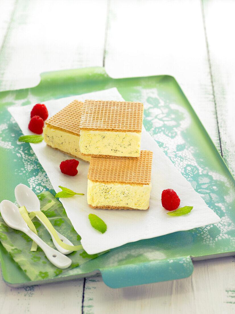 Vaniila ice cream gaufrette sandwiches and raspberries