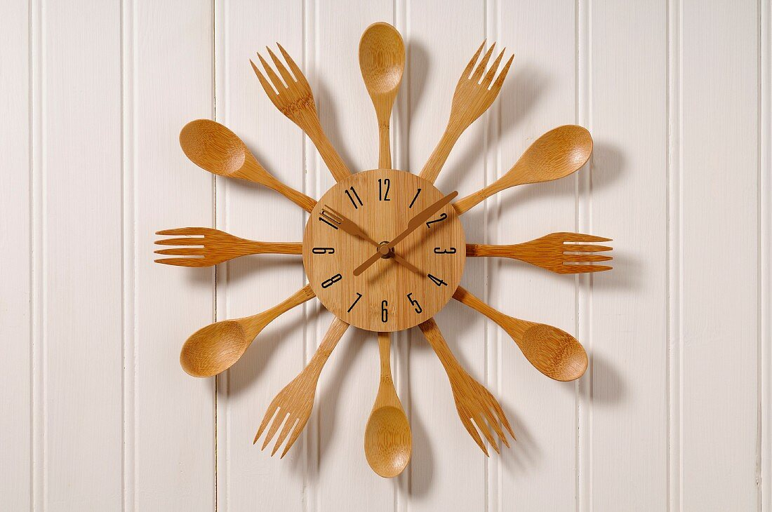 Clock made with wooden cutlery