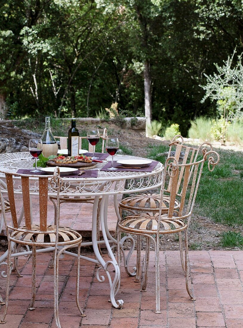 Lunch table on a terrace outdoors in Toscany