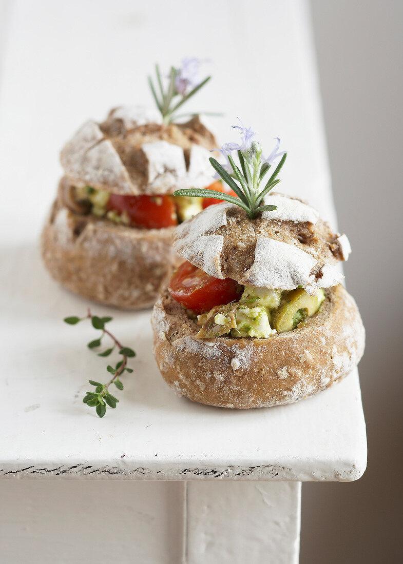 Feta, pesto, olive and tomato bread buns