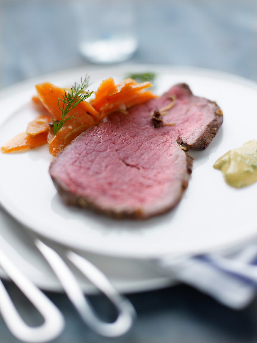 Slice of roast beef with carrots, tarragon and mustard sauce