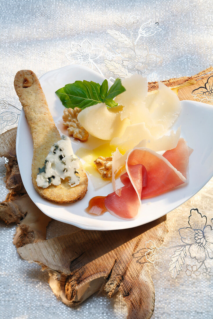 Plate of parmesan, roquefort,Parma ham and pear