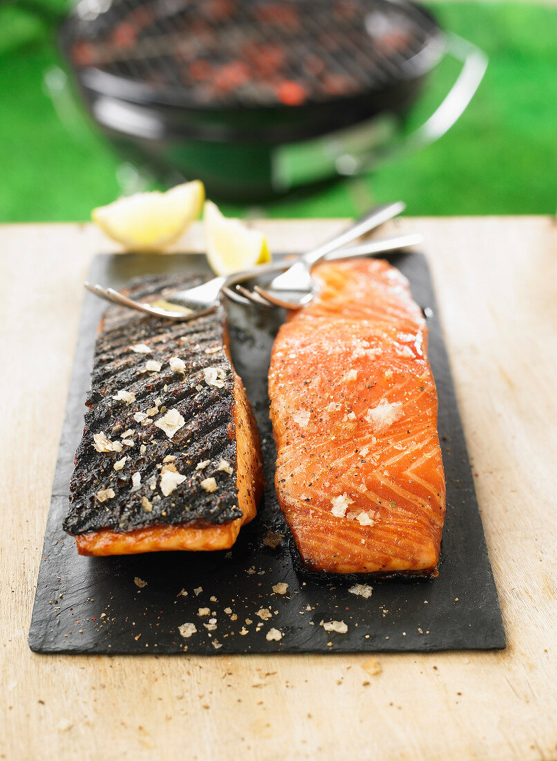 Grilled salmon cooked on one side on the barbecue