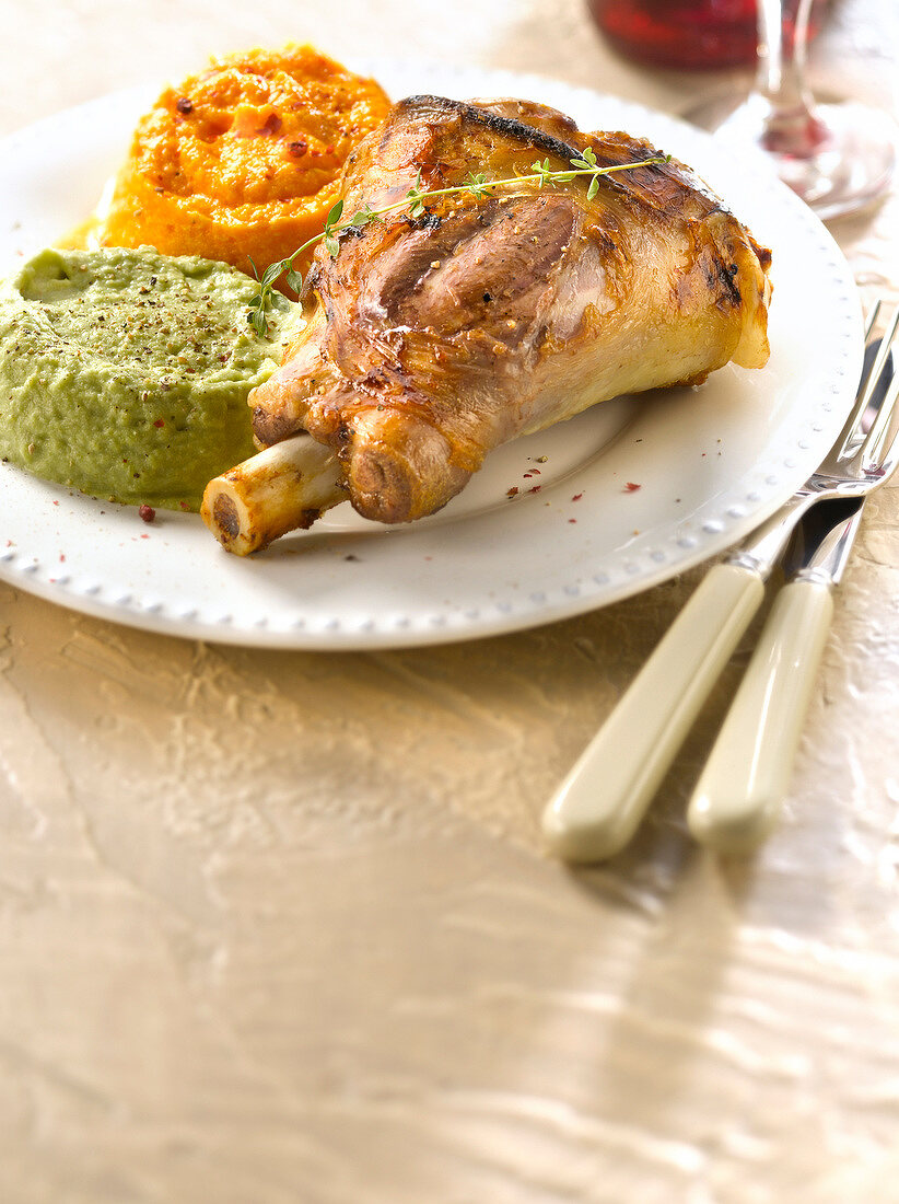 Caramelized knuckle of lamb,broad bean puree and carrot puree