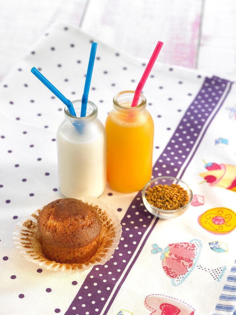 Milk, orange juice and madeleines for a kid's breakfast