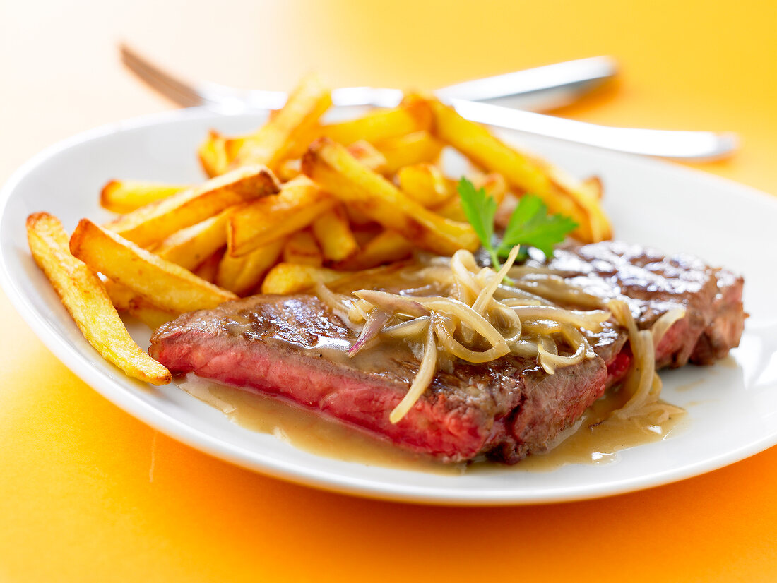 Rare steak with french fries
