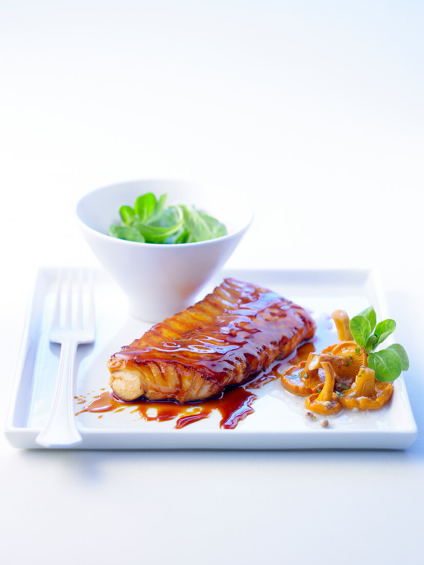 Cod in honey sauce with chanterelles,corn lettuce salad