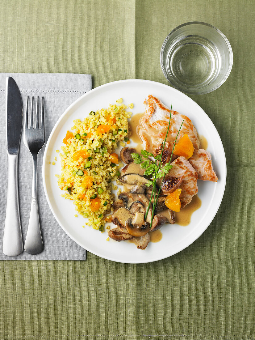 Turkey escalope,bulghour with dried fruit and creamy mushrooms