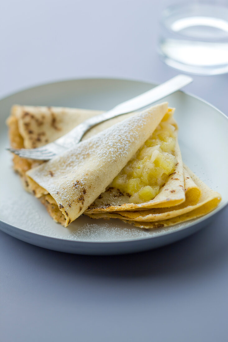 Crepes garnished with stewed apples