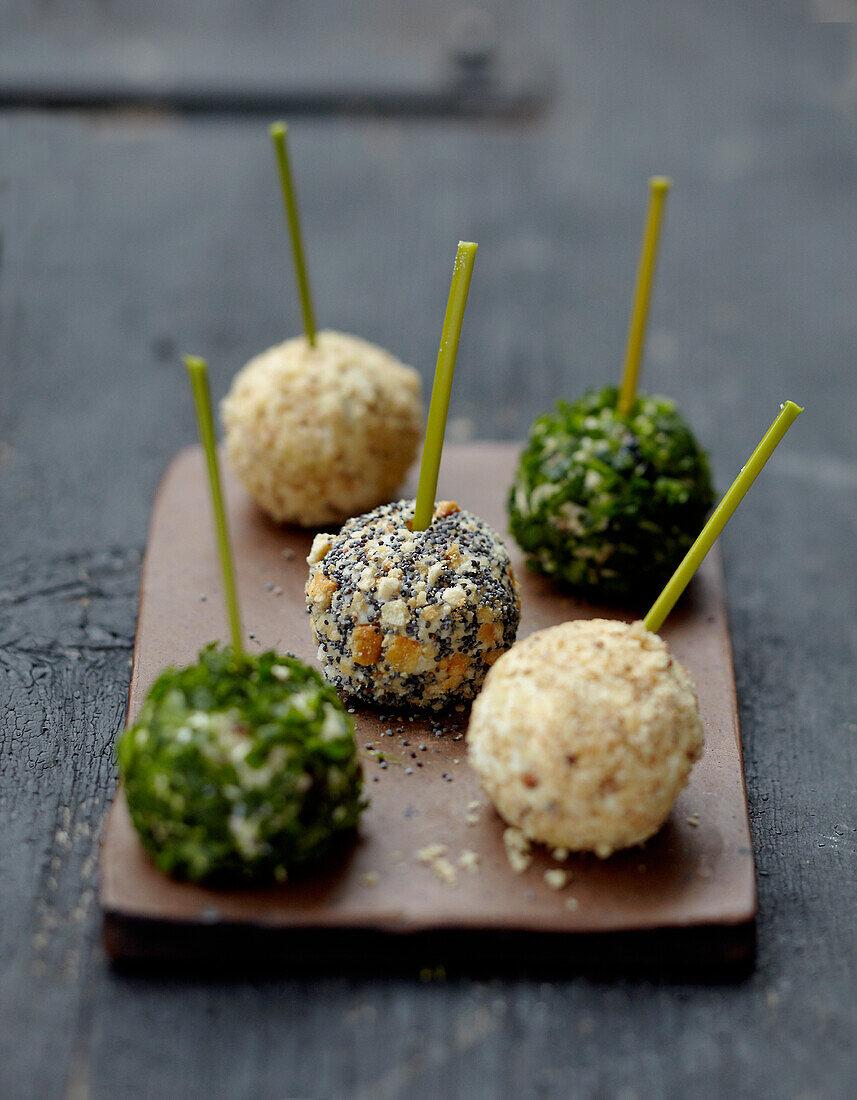 Three-flavored goat's cheese bites on sticks