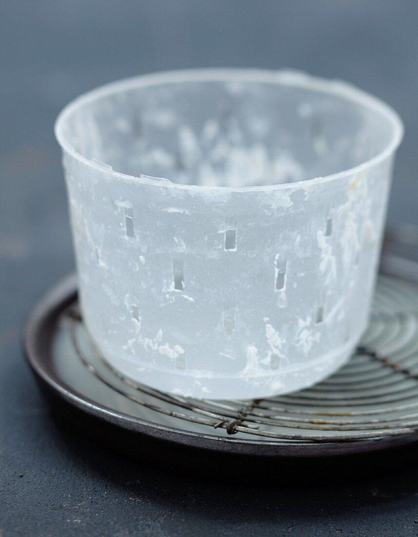 Empty Faisselle pot