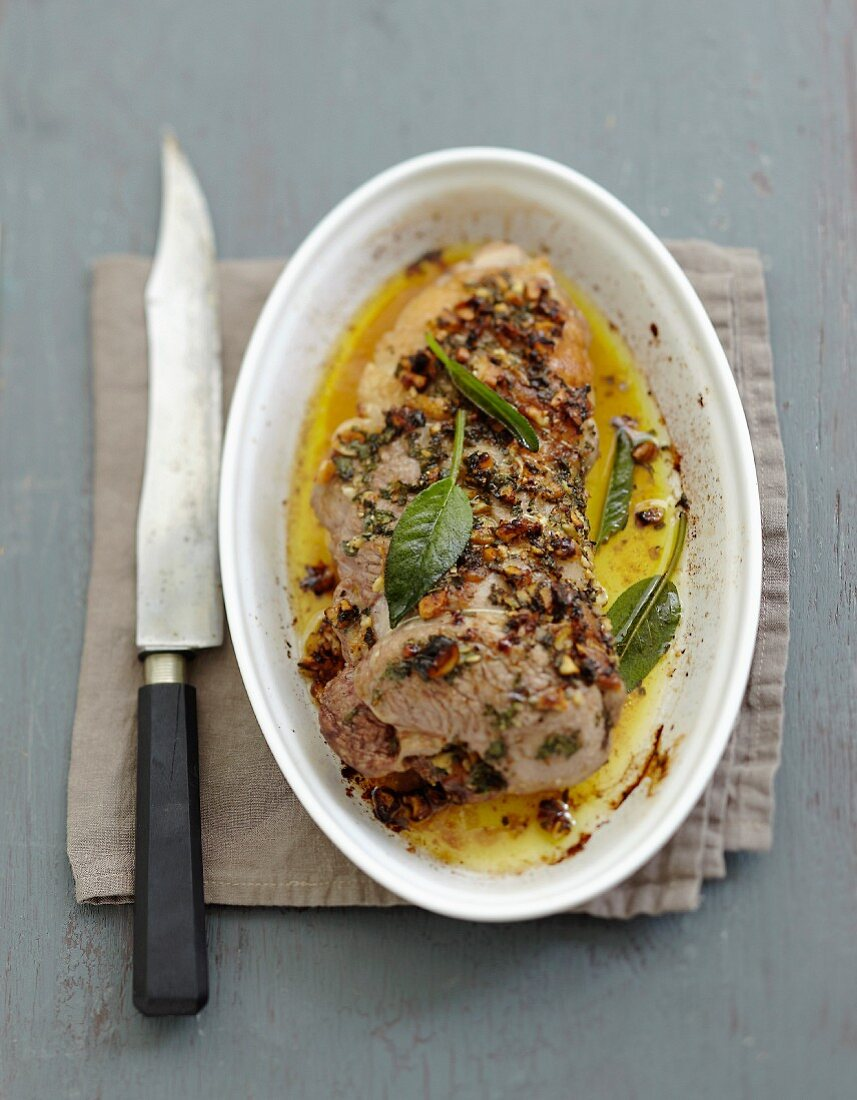 Leg of lamb in sage butter with walnuts
