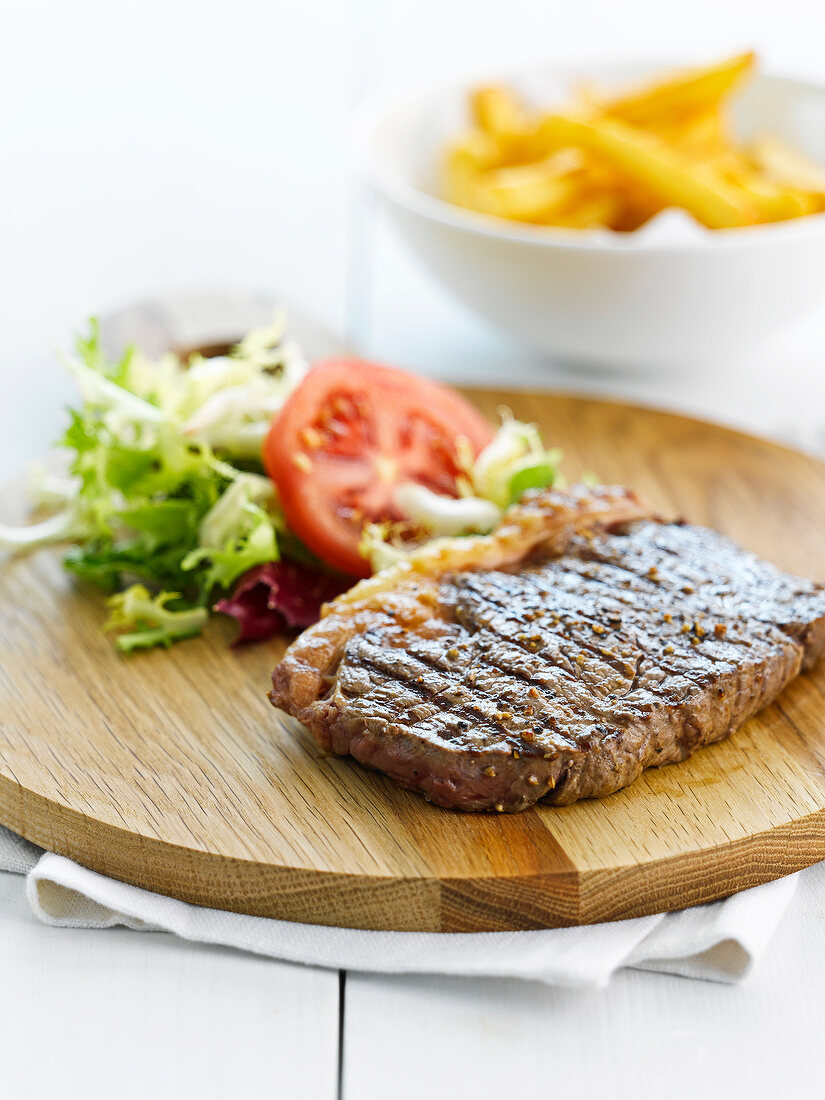 Grilled sirloin steak with mixed salad and french fries