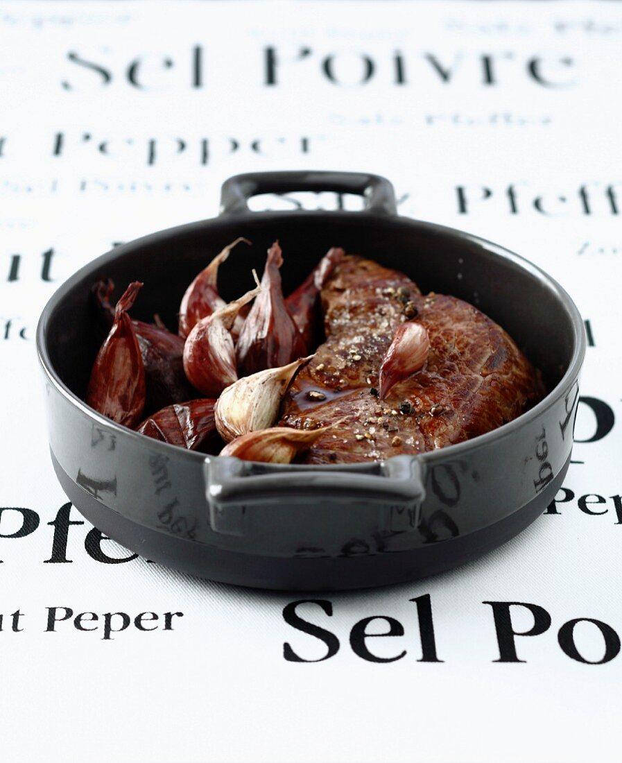 Sirloin steak casserole with shallots and garlic