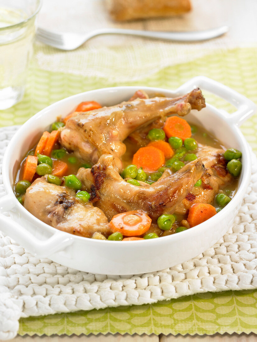 Rabbit in sauce and spring vegetables