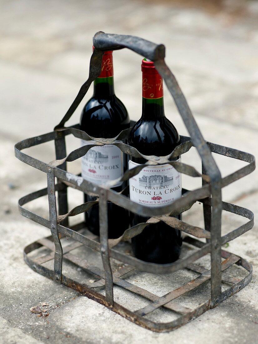 Bottles of Château Turon La Croix in a metal rack