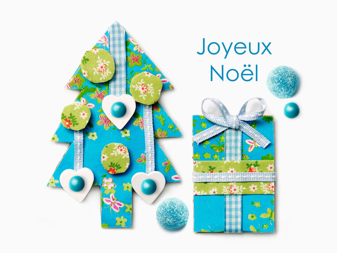Blue paper Christmas tree and present