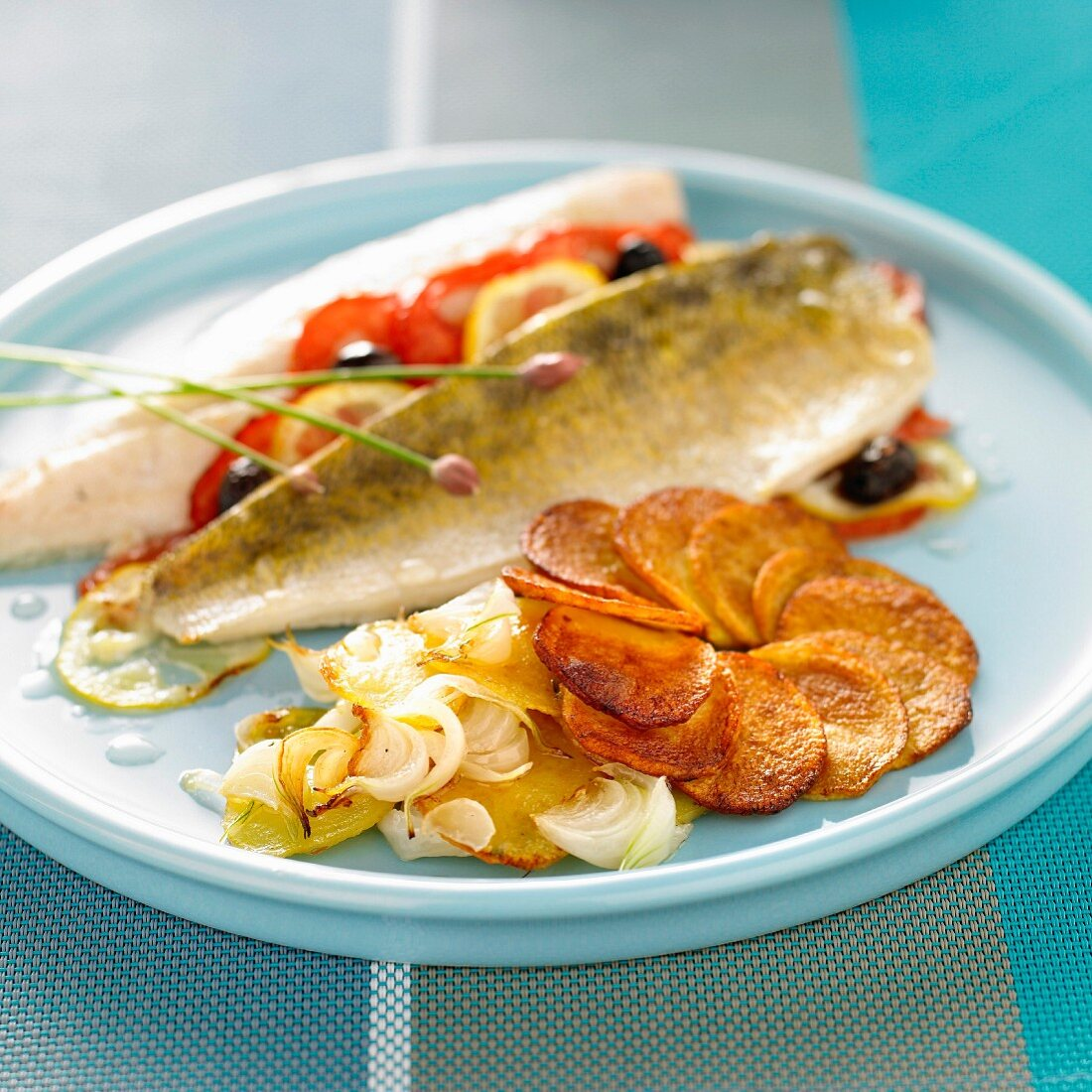 Pike-perch fillet with tomatoes and olives, sauteed potatoes and spring onions