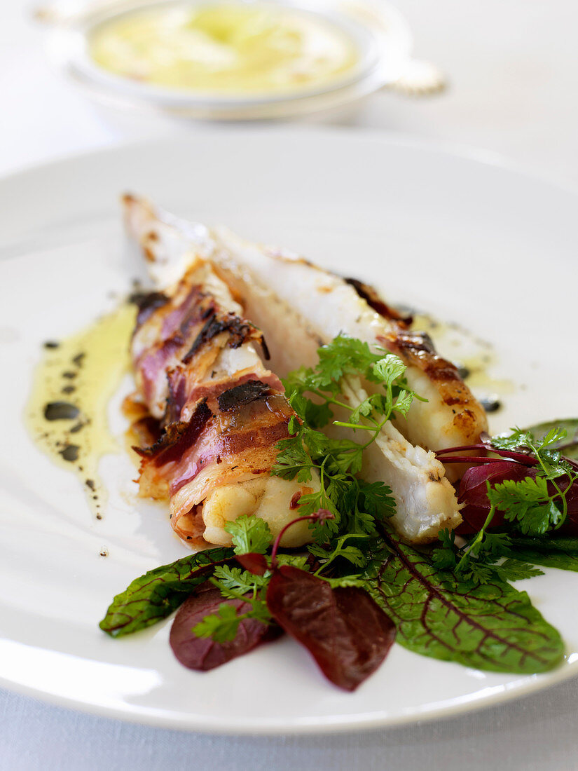 Monkfish tail wrapped in Bigorre bacon