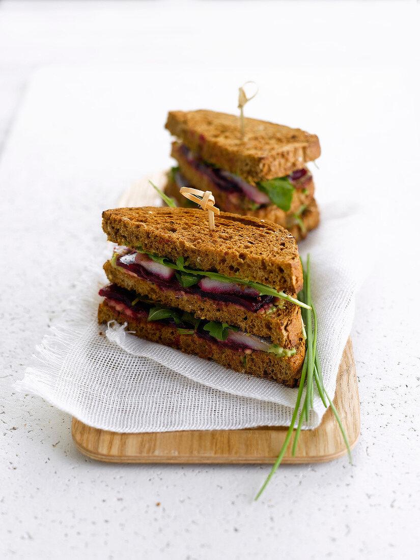Herring, beetroot and avocado brown bread sandwich