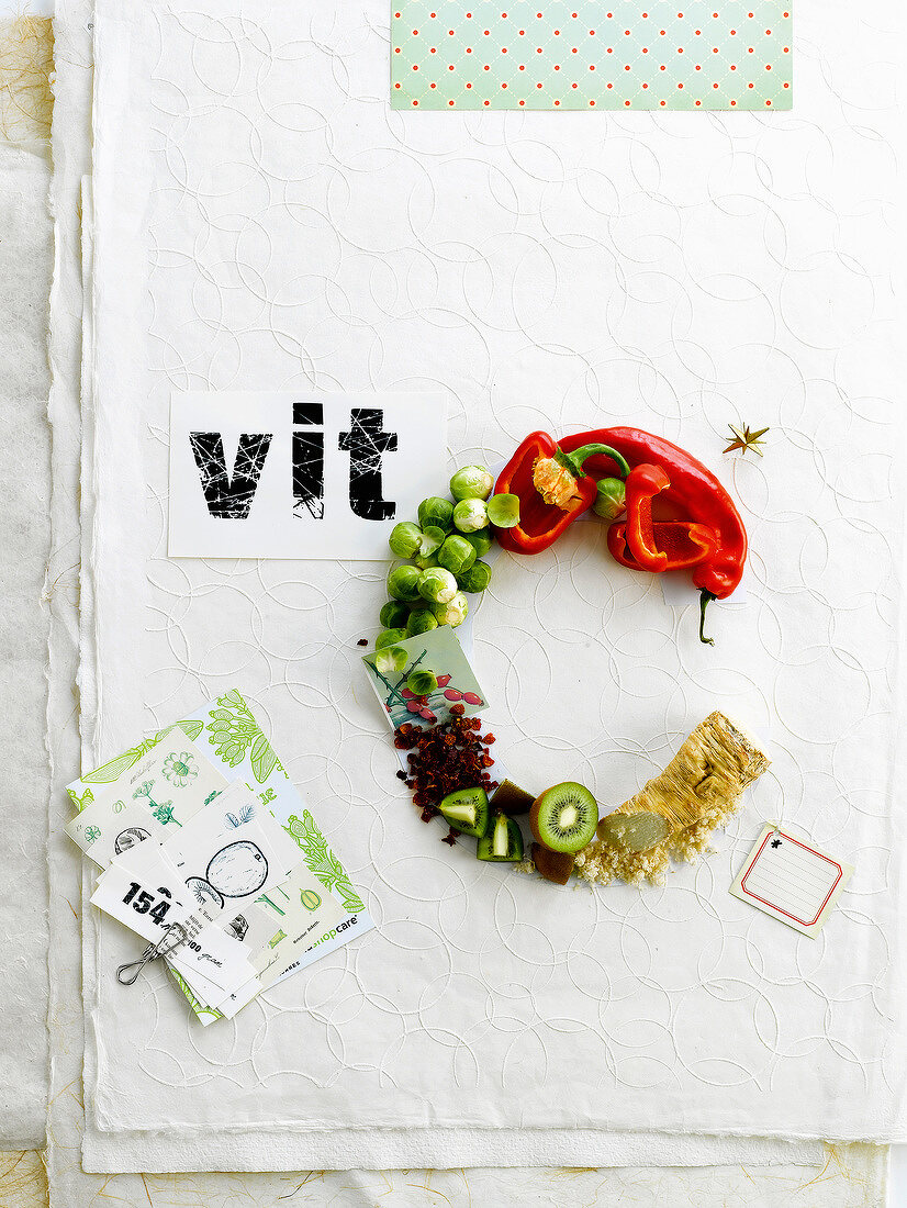 Chemical symbol vitamin C written with food
