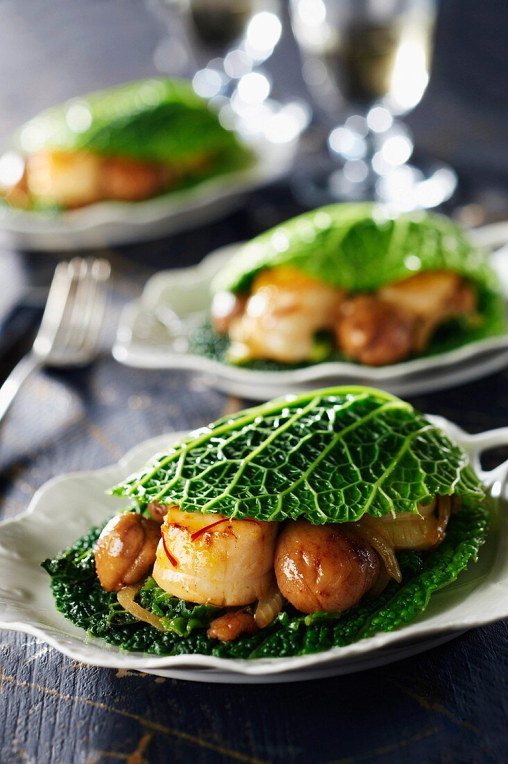 Scallops and chestnuts in cabbage leaves