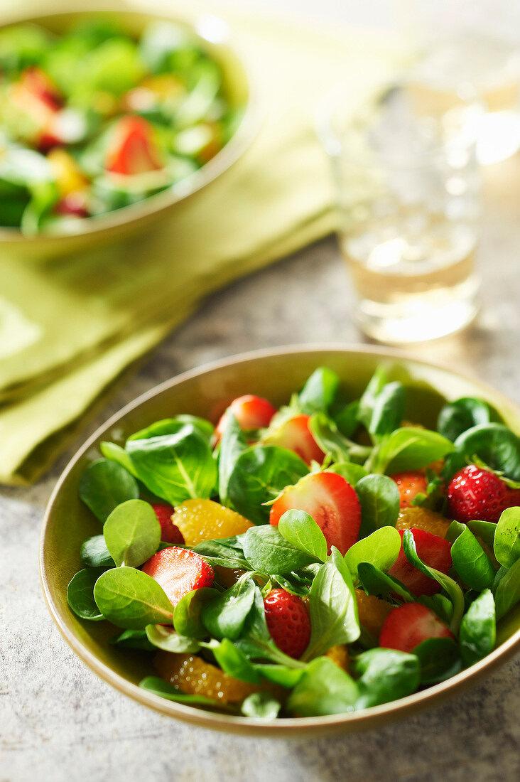 Corn lettuce,Plougastel strawberry and orange sweet salad